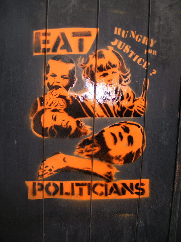 Revolting Mass stencil at Anti Austerity March